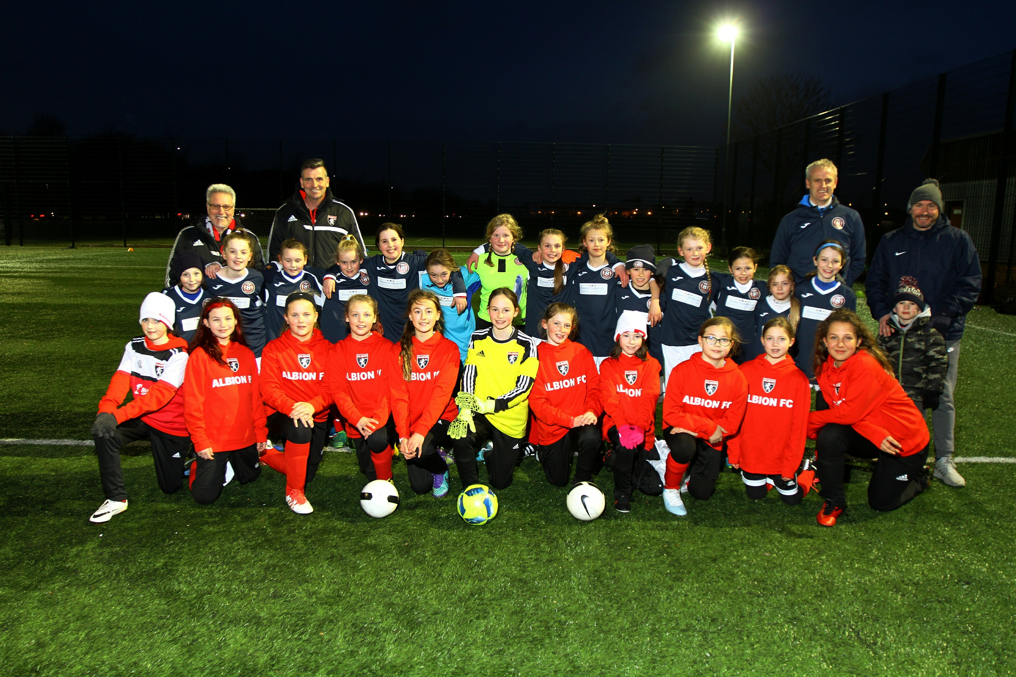 The girls of Albion FC, front row, from Vancouver, Canada, and Dundee East Girls U-11's with their coaches, before their challenge match