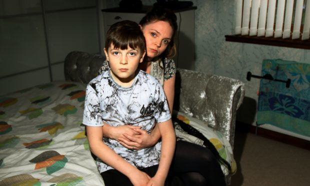 Kara Mitchell and her son Aaron in the bedroom where they barricaded themselves, when an intruder broke into the house.