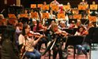 Some of the Dundee schoolchildren rehearsing with the RSNO at the Caird Hall in Dundee