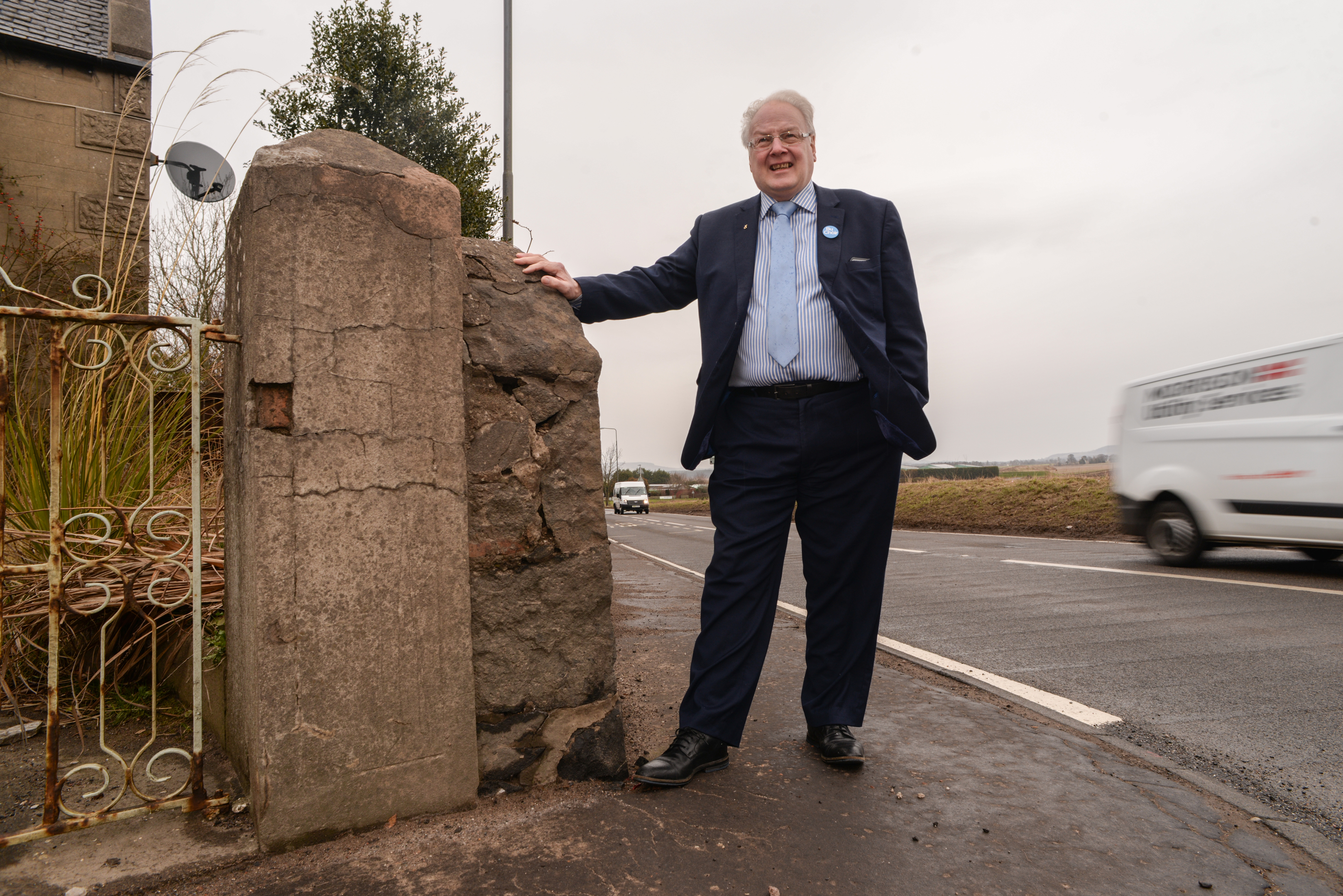David MacDiarmid stands by the wall which will be re-modeled to allow motorists better visibility at the crosskeys junction, Freuchie.