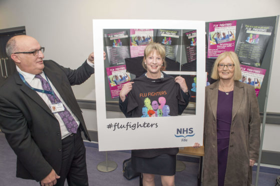Scottish Health Secretary Shona Robison joined NHS Fife Chief Executive Paul Hawkins and Chair of NHS Fife Tricia Marwick in their Flu Fighters campaign during a visit to the Victoria Hospital in Kirkcaldy.