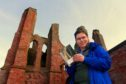 Mr Deak with a Sir Walter Scott novel at his beloved Arbroath Abbey.