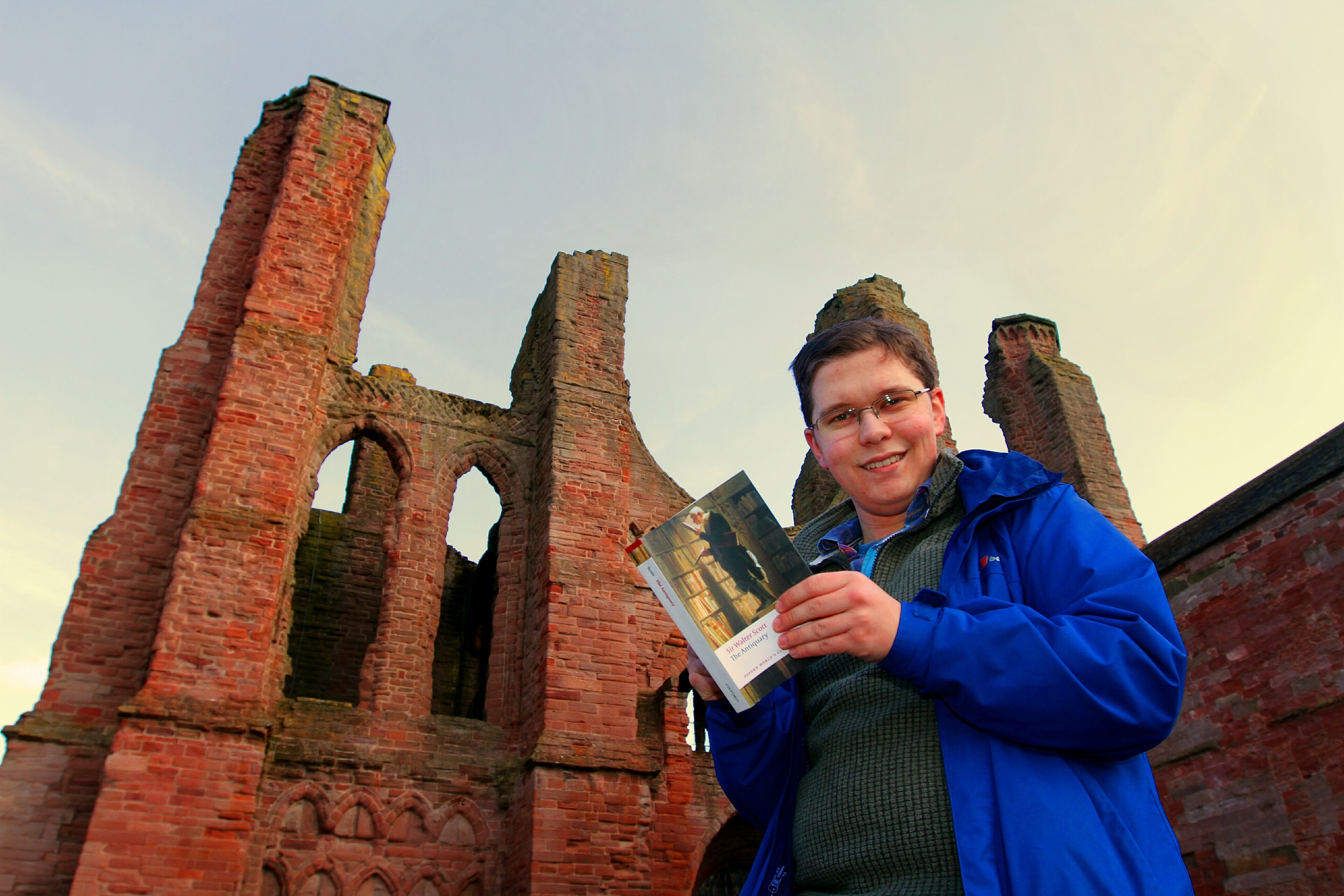 Mr Deak with a Sir Walter Scott novel at his beloved Arbroath Abbey.