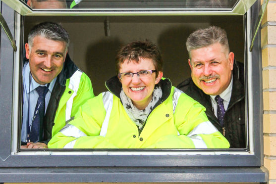 Committee convener Judy Hamilton (centre) has warmly welcomed the cash for housing across Fife.