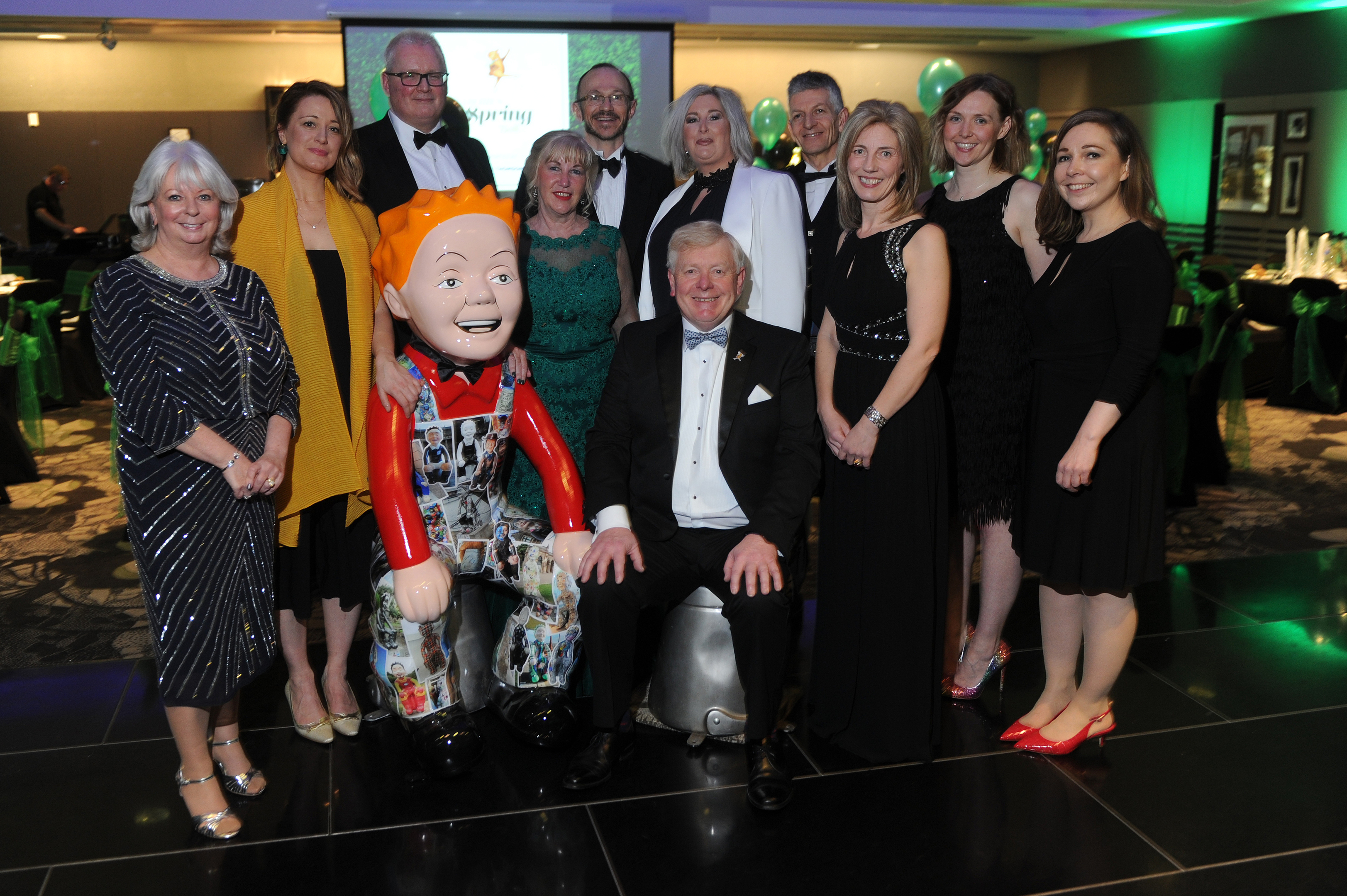 Gillian Bayford, wearing white, is pictured with the ARCHIE committee and Wullie at Friday night's bash.