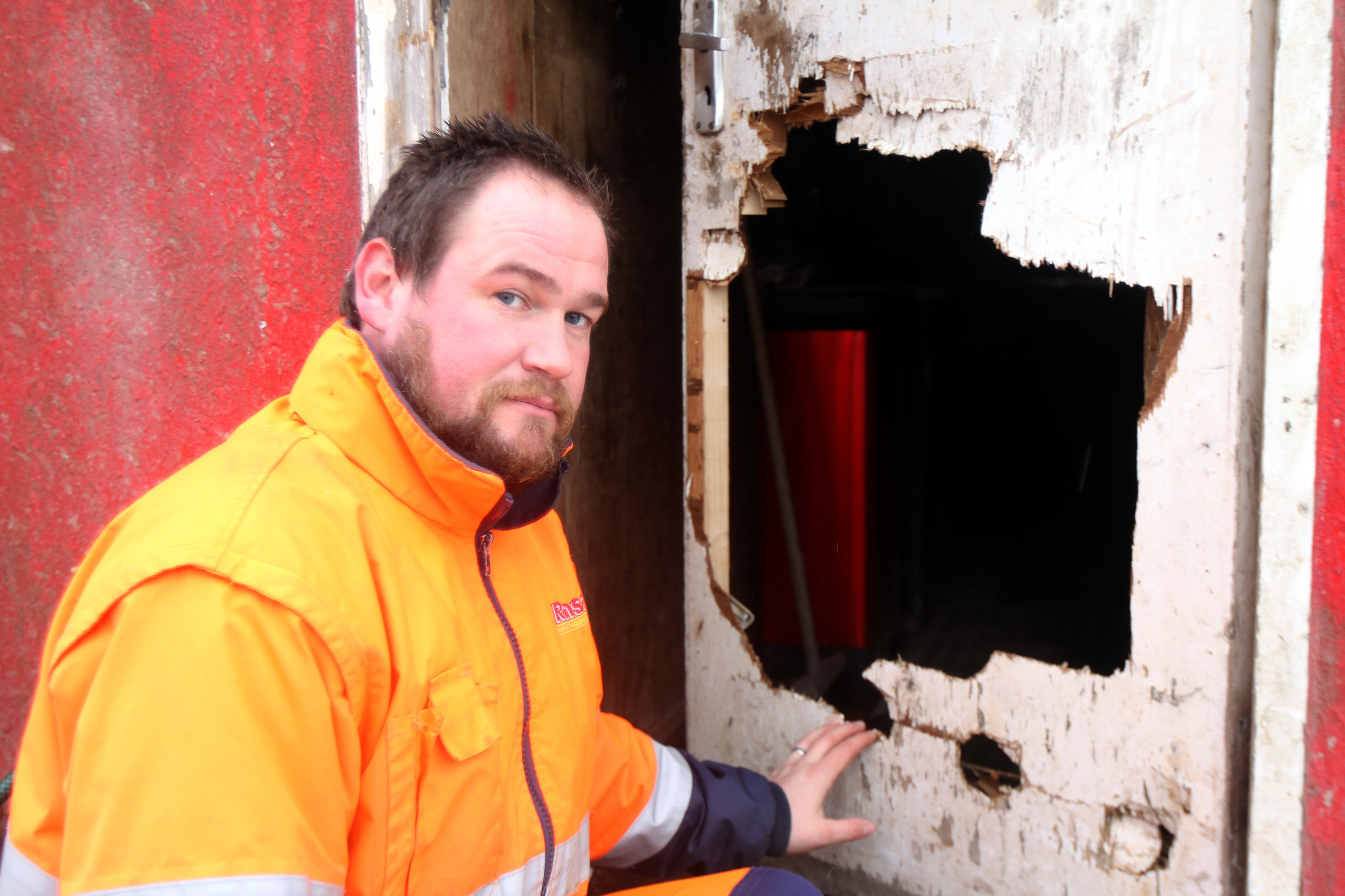 James Ross of Ramsay Skip hire beside some of the damaged property.