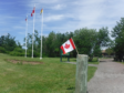 Flags at full flutter on the road from Shediac to Miramichi.