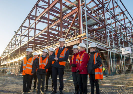 Bertha Park High School is one of the projects to help cater for a growing population - John Swinney MSP with come of the pupils from local feeder primary schools for the new school.