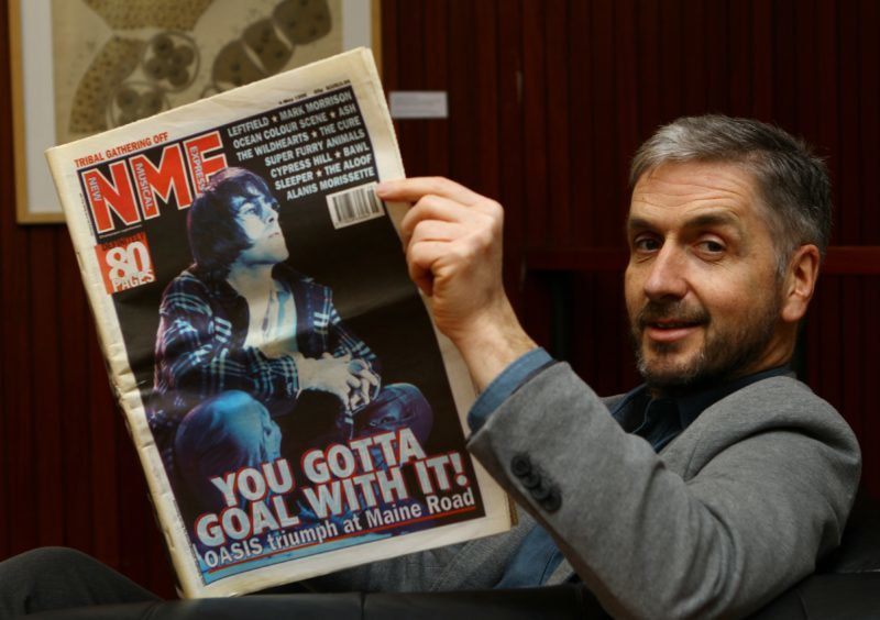 Former Courier Rocktalk writer Roddy Isles with a 1996 copy of the NME.