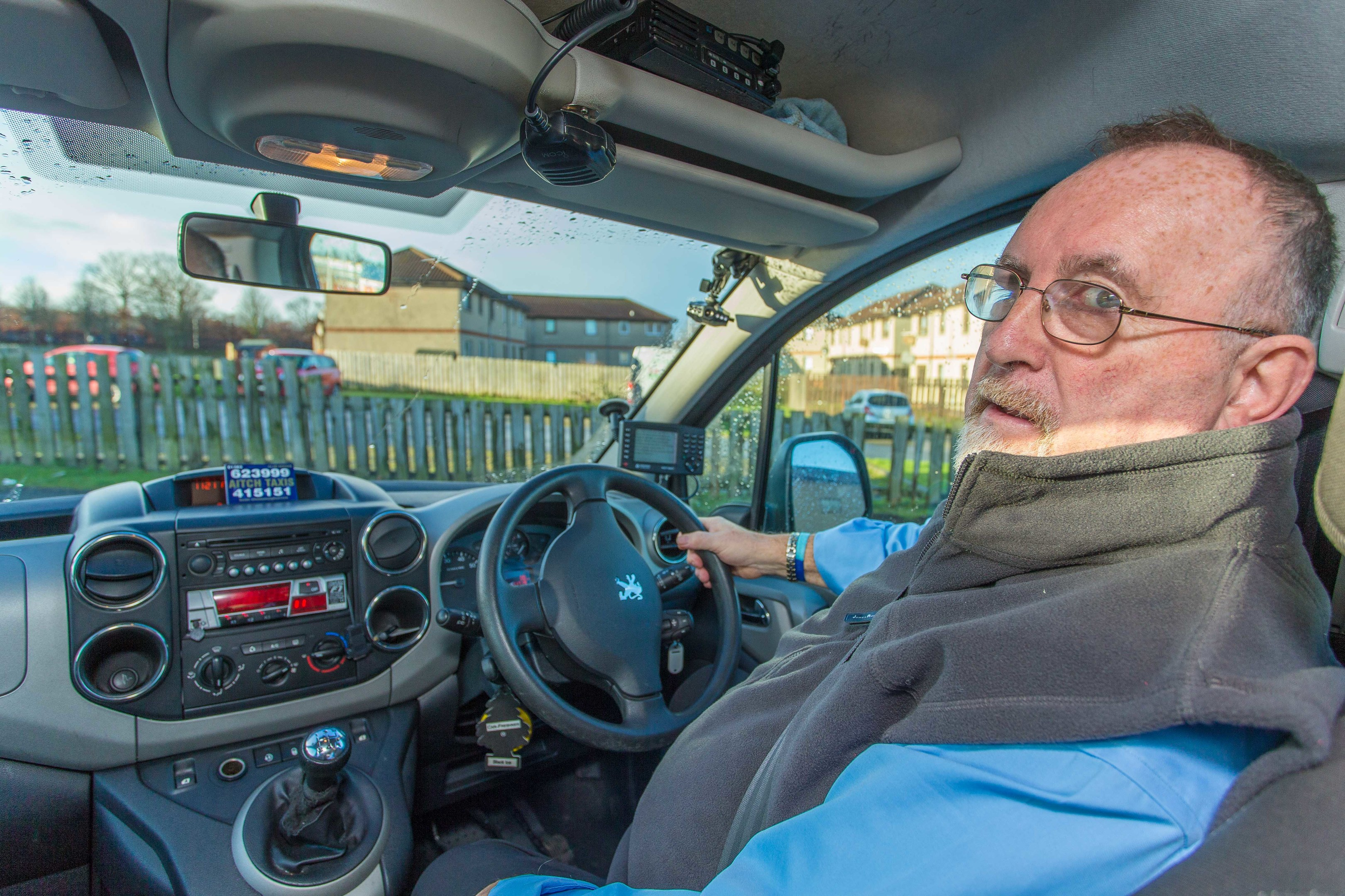 John Aitchison of A1tch Taxis showing the CCTV camera system used in their vehicles.