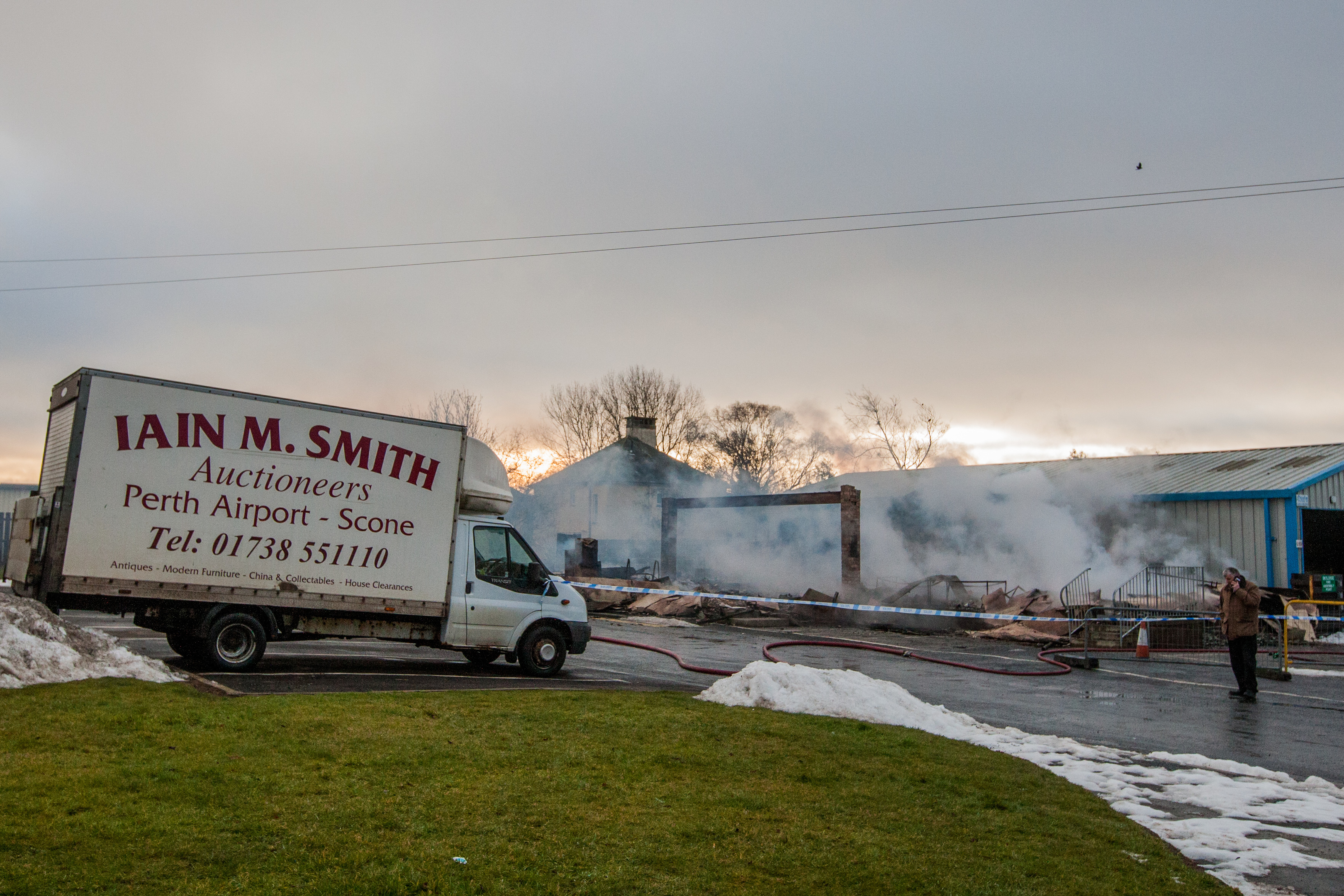 Tele News - Dundee - unknown reporter Story. Fire destroys building belonging to Iain M Smith Auctions at Perth Airport. Picture shows the ruin still smoking. Iain M Smith Auctions, Perth Airport, by Scone. Friday 9th March 2018.