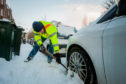 Beast from the East scenes in Perth from early March. Picture shows Mark Smith digs his car out of the snow to attempt to get to work (for Contraflow). Windsor Terrace, Perth.