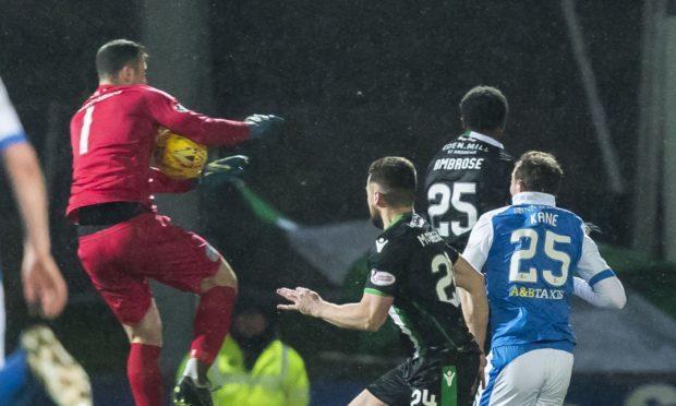 Hibs goalie Ofir Marciano Handles the ball outside his box.