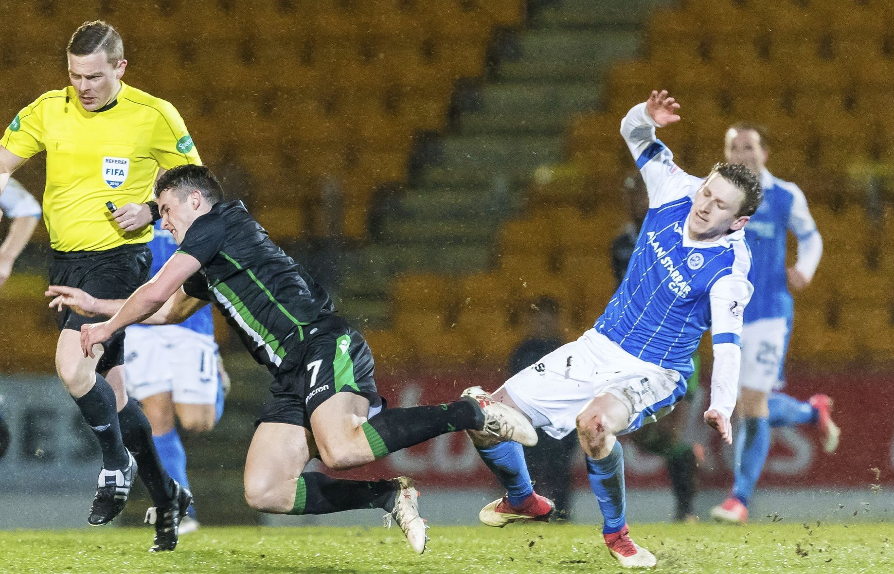 Saints' Blair Alston fouls John McGinn of Hibs.