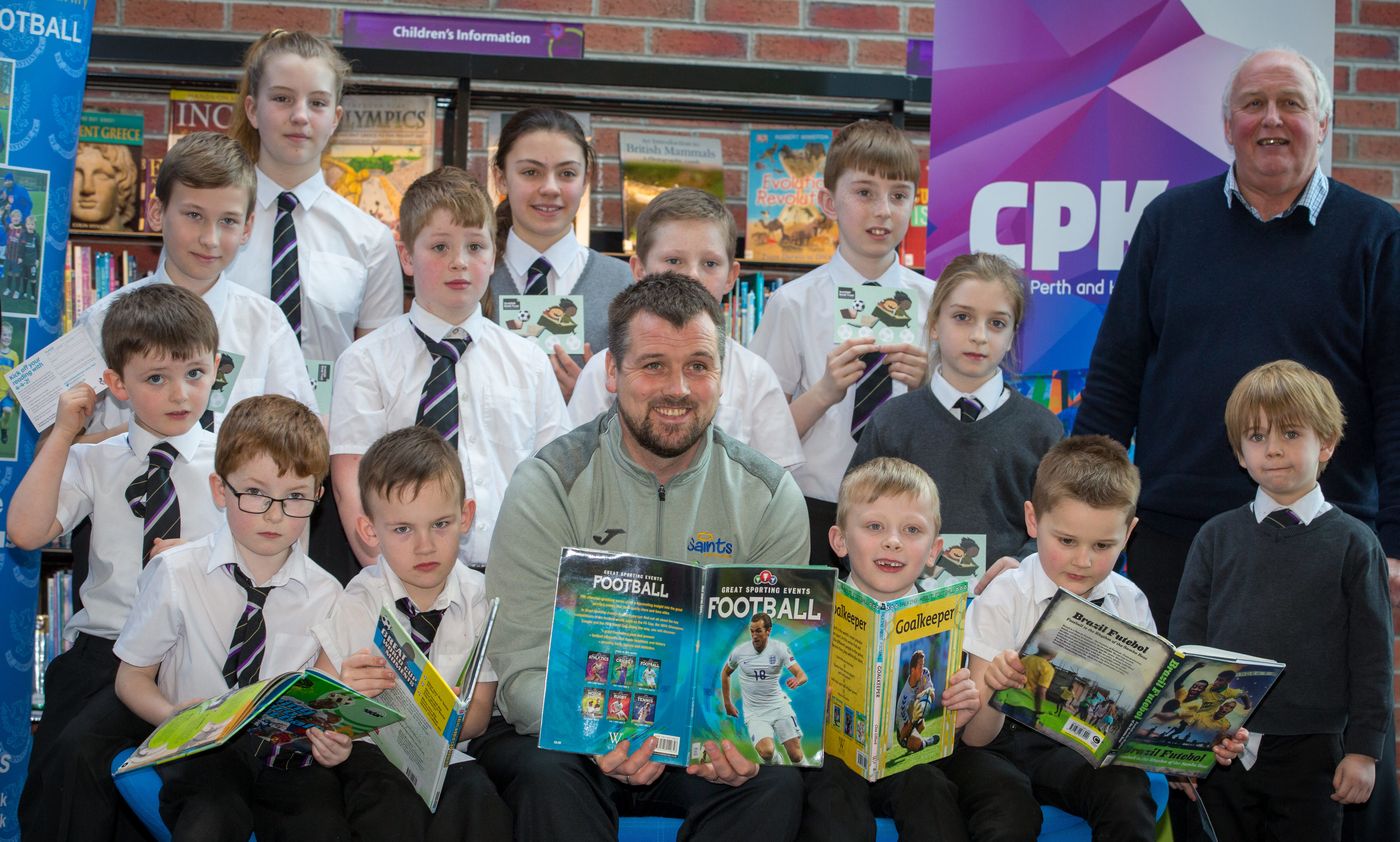 Danny Griffin of St Johnstone joined Atholl Henderson (Chief Executive Saints Community Trust) and Jill MacKintosh (P&K Library Services Co ordinator) and local schoolchildren to help launch the Saints new 4-4-2 reading initiative at the North Inch Community Campus
