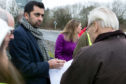 Transport Minister Humza Yousaf speaks to North Glenrothes Community Council's Ron Page.