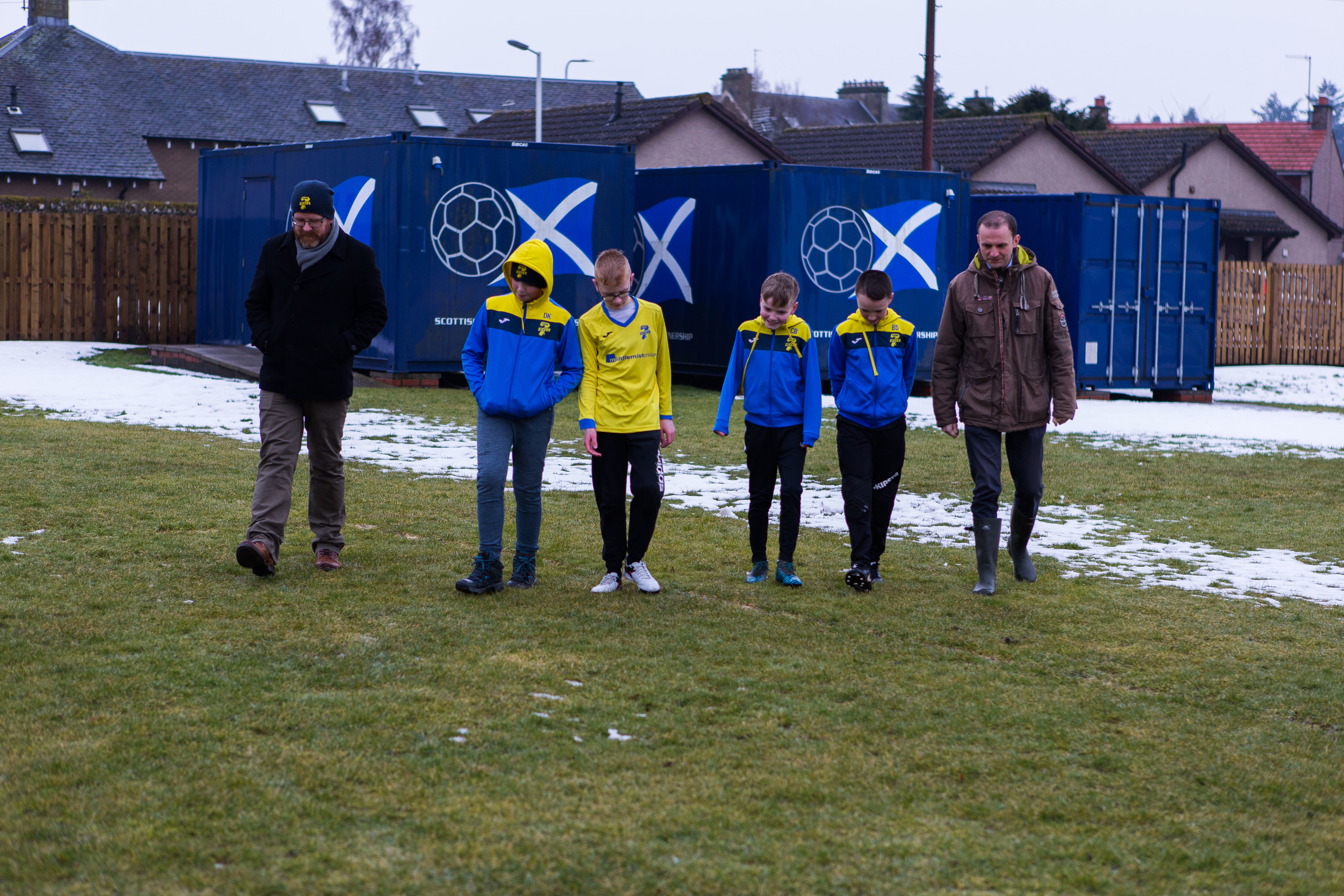 Cupar Soccer Sevens' chairperson Kevin Bain, Darragh King, Cal Bain, Callum Blair, Brandon Seath and MP Stephen Gethins check out the dog mess on their Ladyinch pitch.