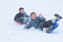 Children having great fun sledging at Riverside Park in Glenrothes after their school was closed by the snow.