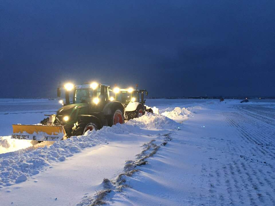 Mike Young's tractor at work north of Anstruther on Thursday night with the stuck council gritter visible in the background
