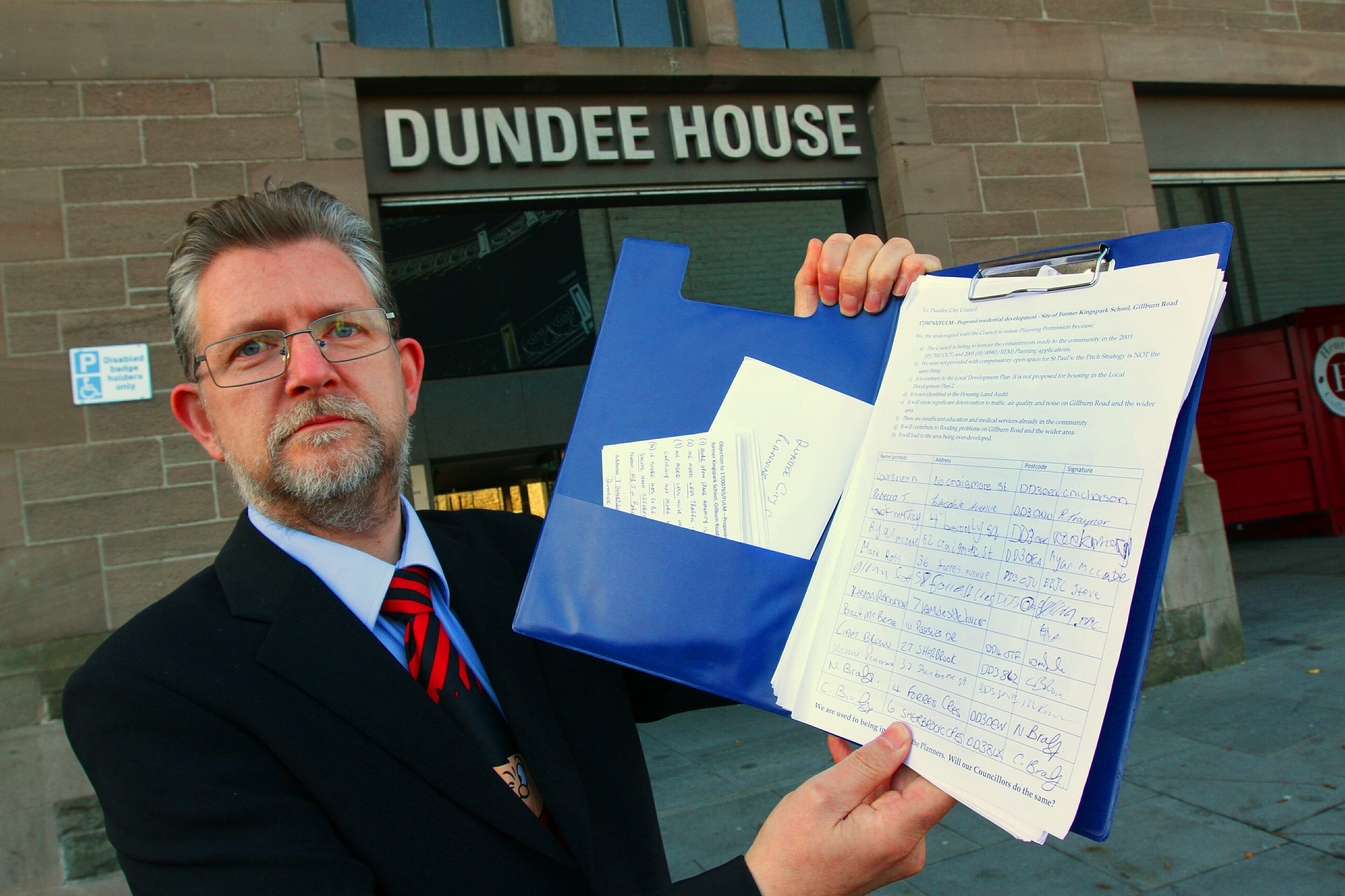 Stephen Cragg with a  petition to stop houses being built on the land of the former Kingspark school.