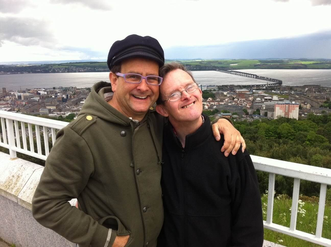Timmy and his late brother Martin pictured on Dundee Law against the backdrop of the River Tay.