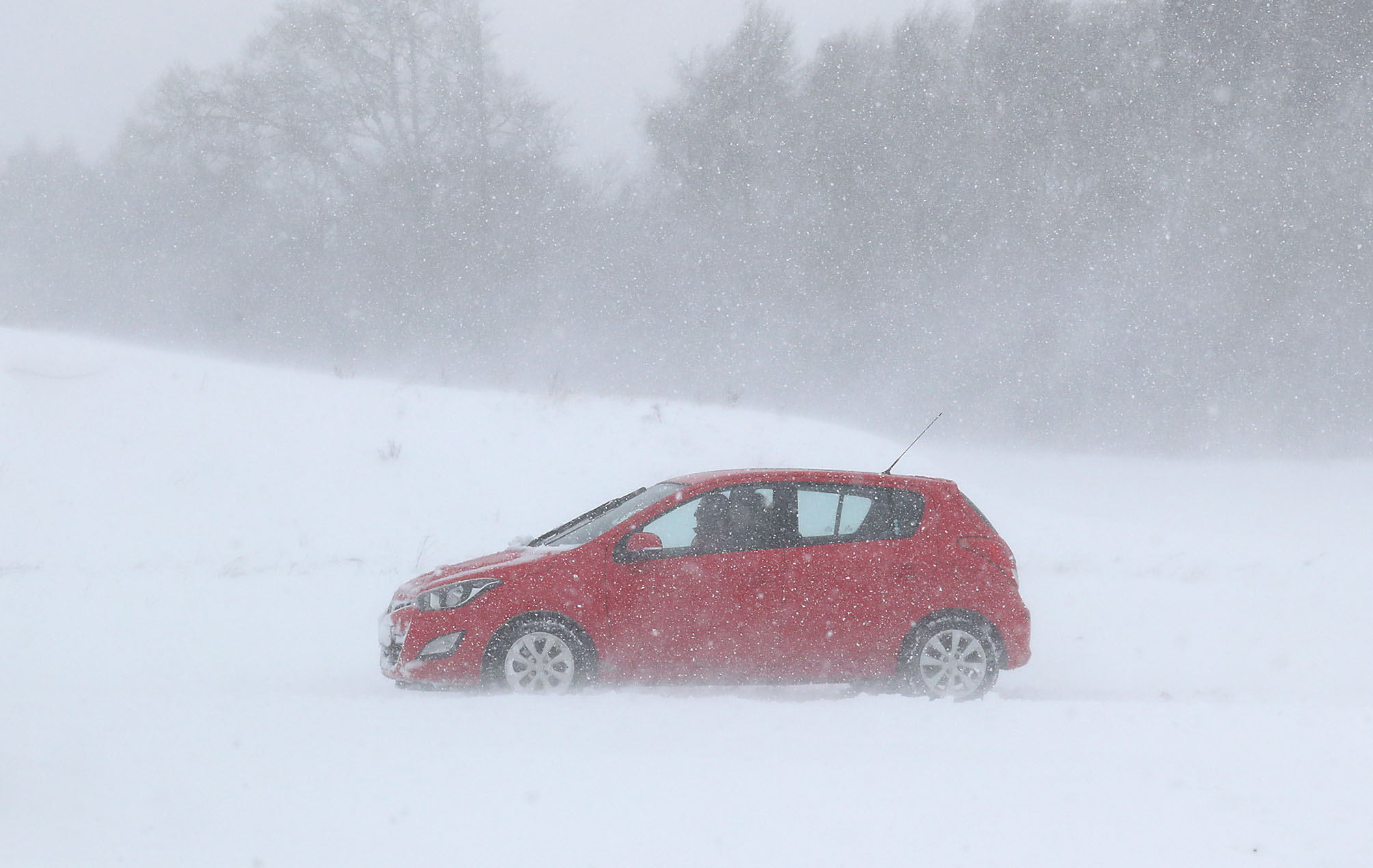 A car in snowy conditions in Larbert, near Falkirk