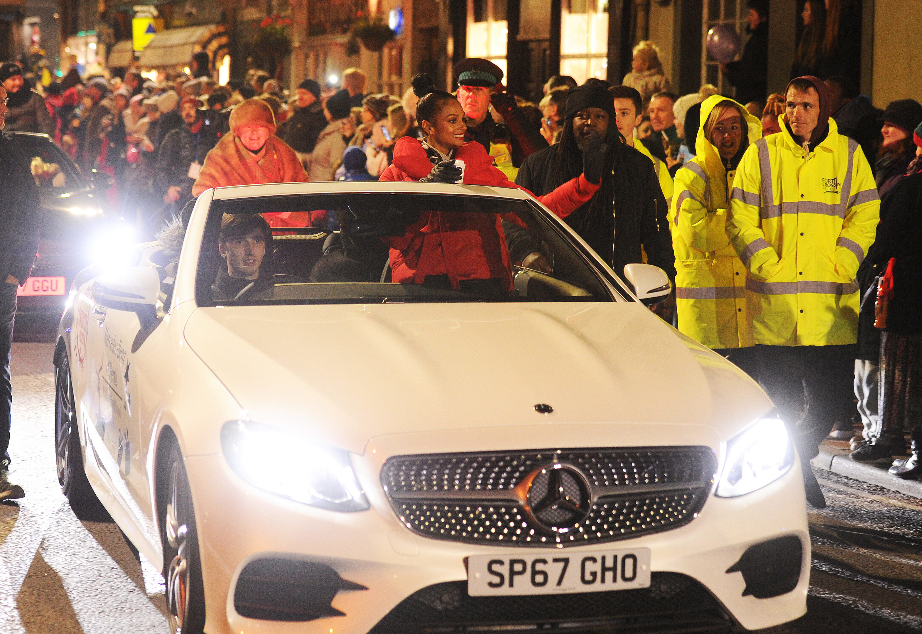 Alesha  Dixon waving to crowds at the Christmas Lights parade,