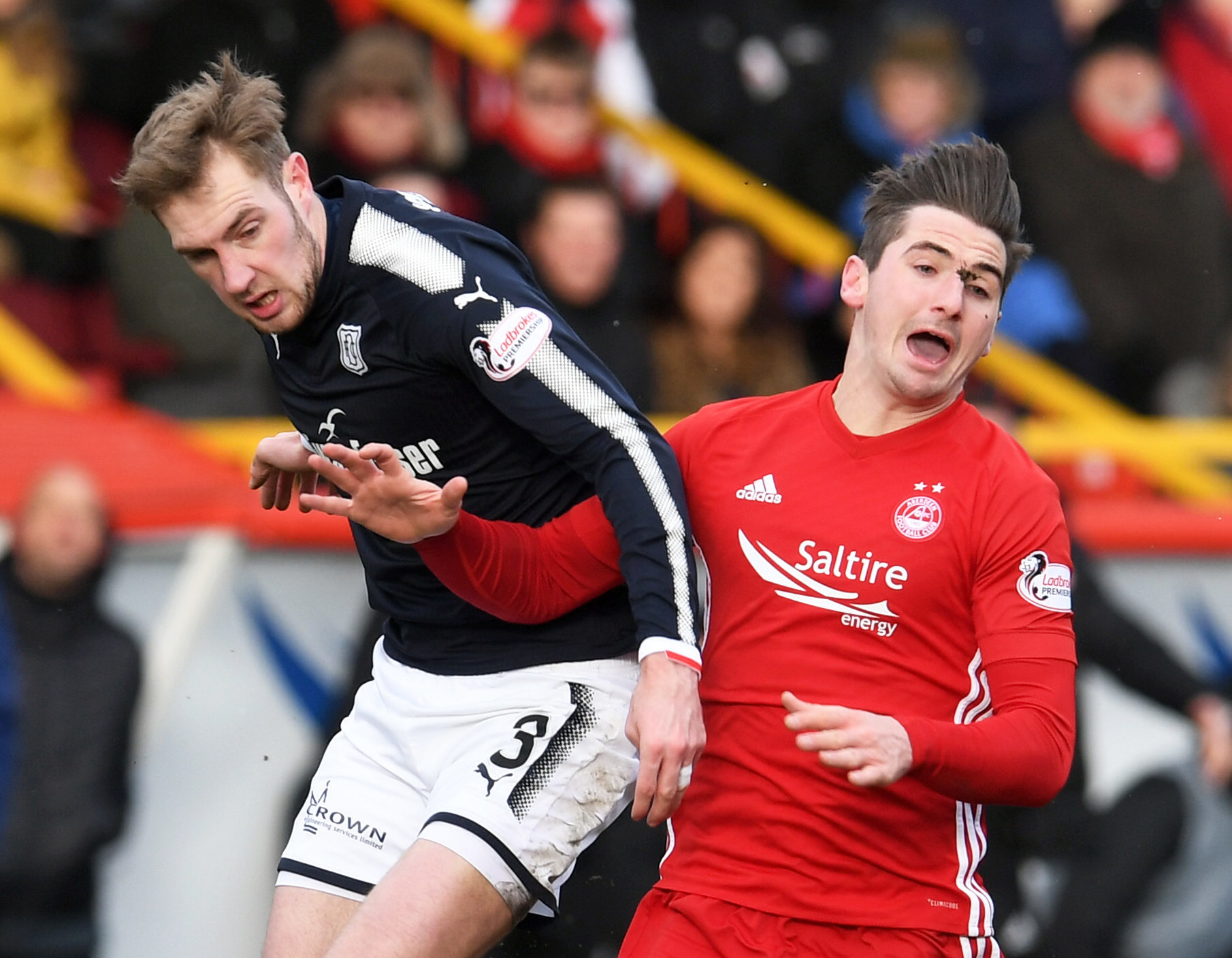 Aberdeen's Kenny McLean battles with Kevin Holt.