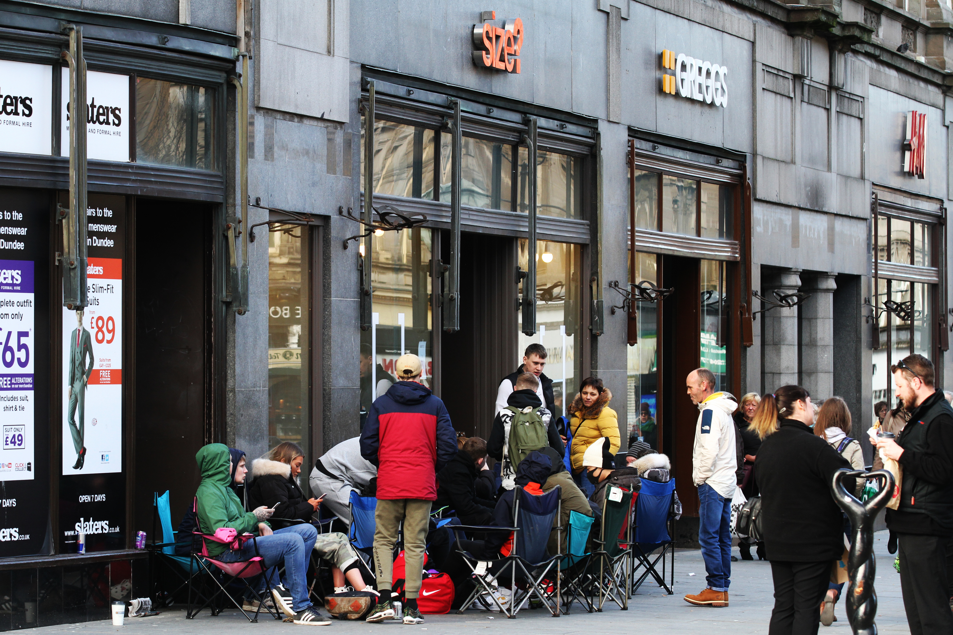 A queue of people on camping chairs is building outside Size? for a new pair of trainers which go on sale tomorrow.
