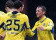 Chris Millar celebrates one of Chris Kane's goals at Dens.