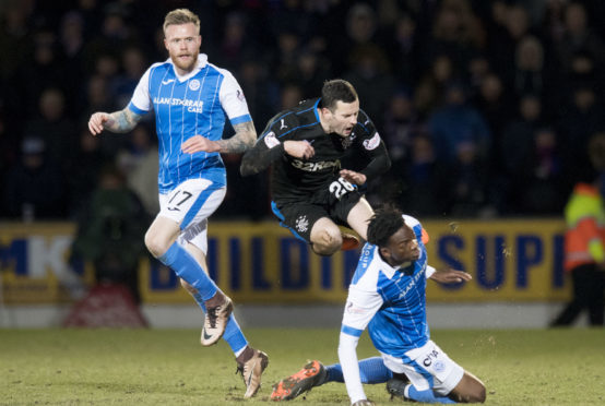 Jamie Murphy is tackled by Matty Willock.