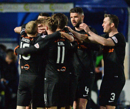 The United players celebrate Matty Smiths first goal.