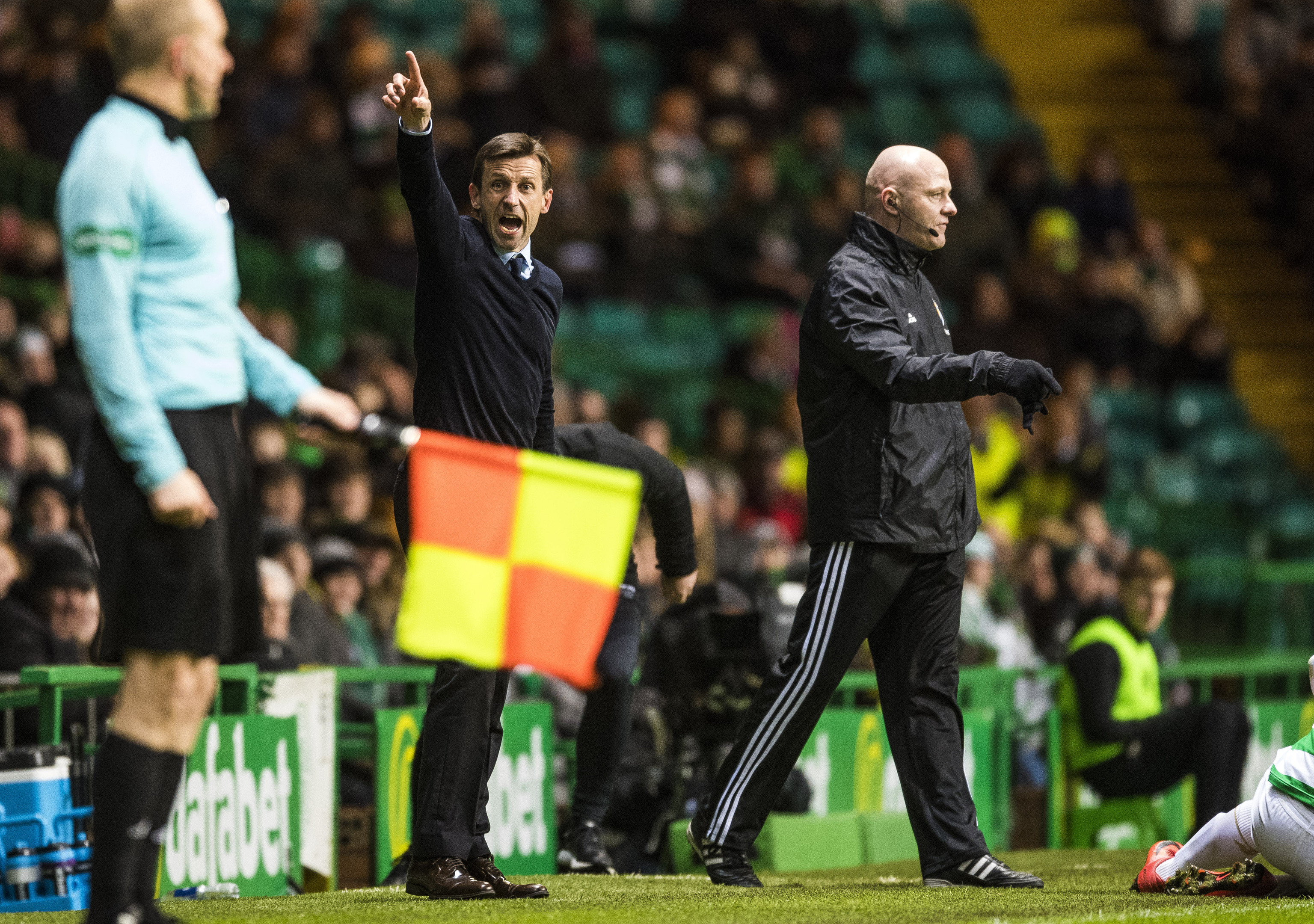 Dundee manager Neil McCann on the touchline at Celtic Park.