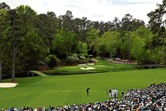 Tiger Woods of the United States plays his first shot from the 12th hole during the final round of the 2018 Masters Tournament at Augusta National Golf Club on April 8.