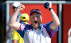 Darren Burnett celebrates during the Men's Lawn Bowls Triple's on day four of the Gold Coast 2018 Commonwealth Games.