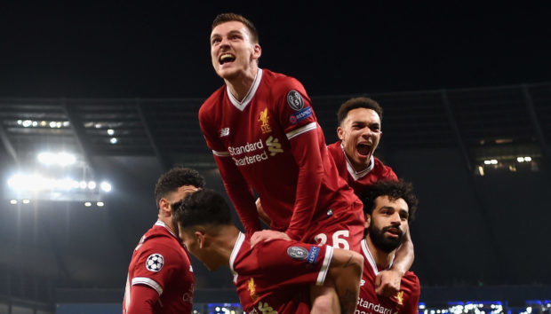 Andy Robertson of Liverpool joins in as the team celebrate their first goal during the UEFA Champions League Quarter Final Second Leg match between Manchester City and Liverpool.