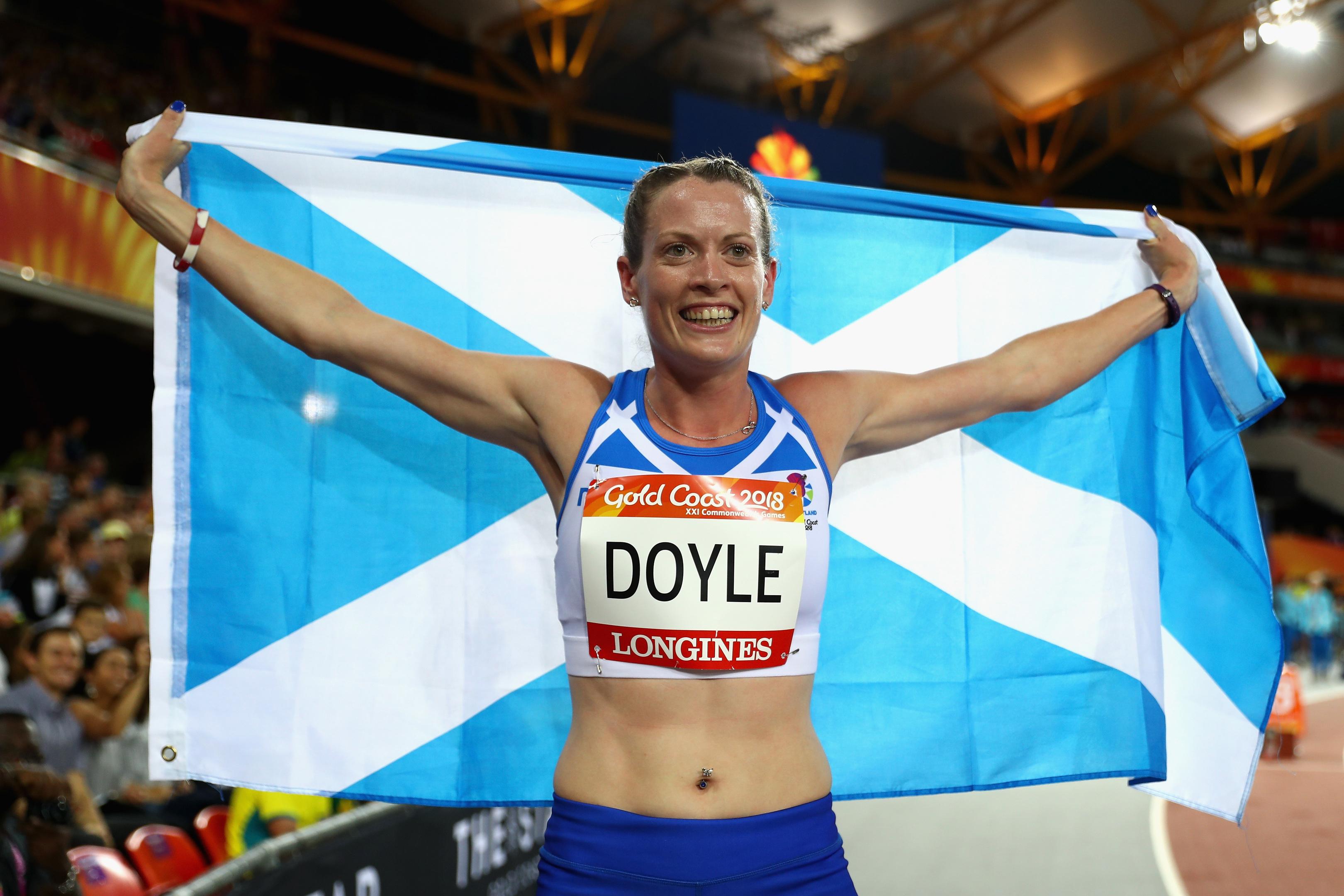 Eilidh Doyle celebrates winning silver in the women's 400 metres hurdles final