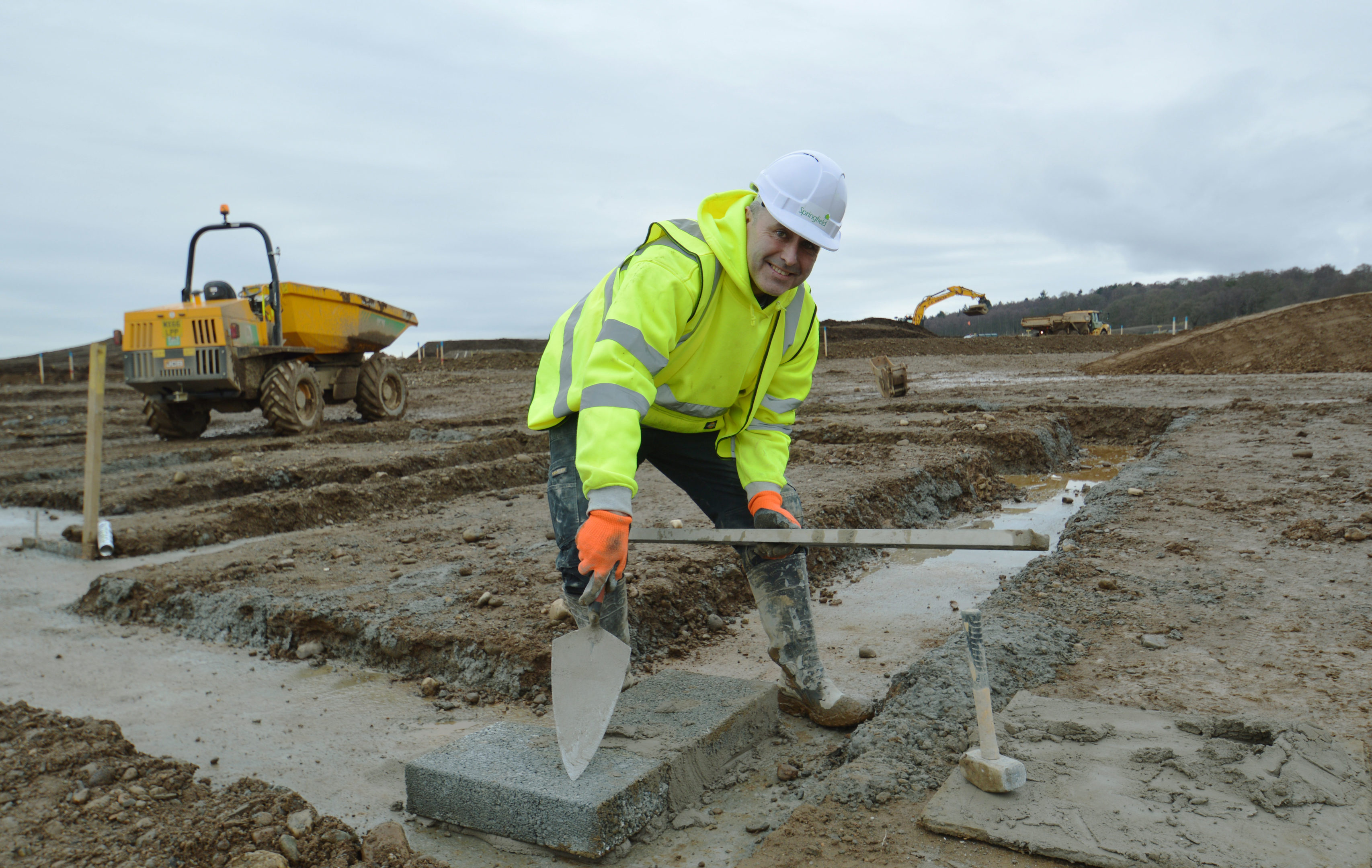 Bricklayer Peter McAninch lays the first bricks at the Bertha Park site.