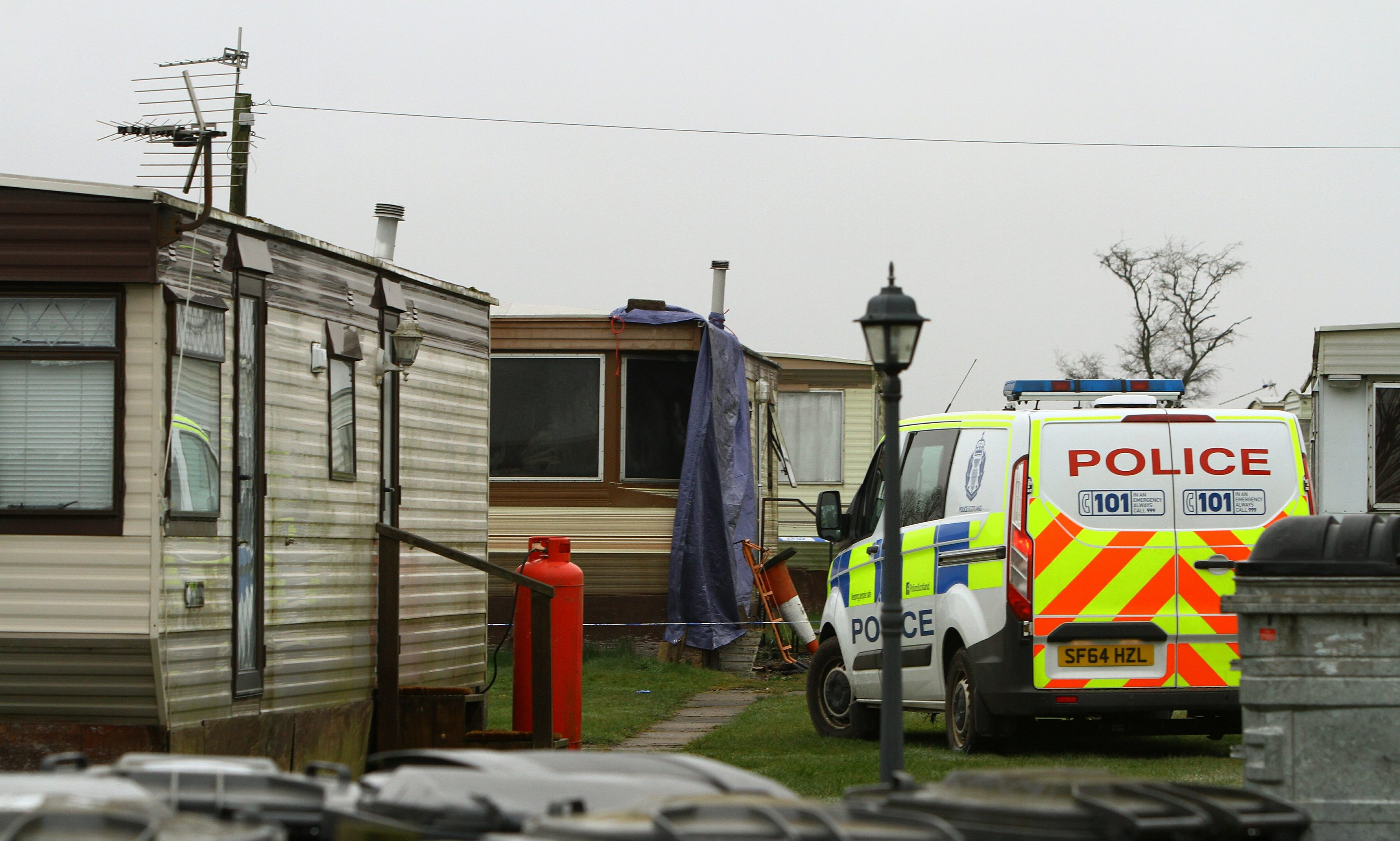 The scene of the fatal fire at Woodley Caravan Park