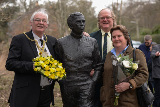 Provost Jim Leishman, Councillor Andy Heer and Eleanor Fleming, chair of the local Community Council, at the Jim Clark memorial, Kilmany.