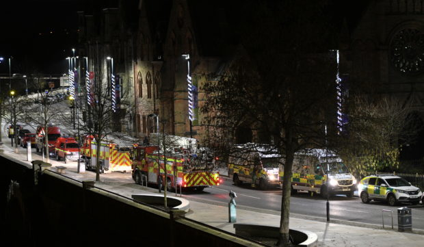 Emergency teams at the scene of the drama last night.