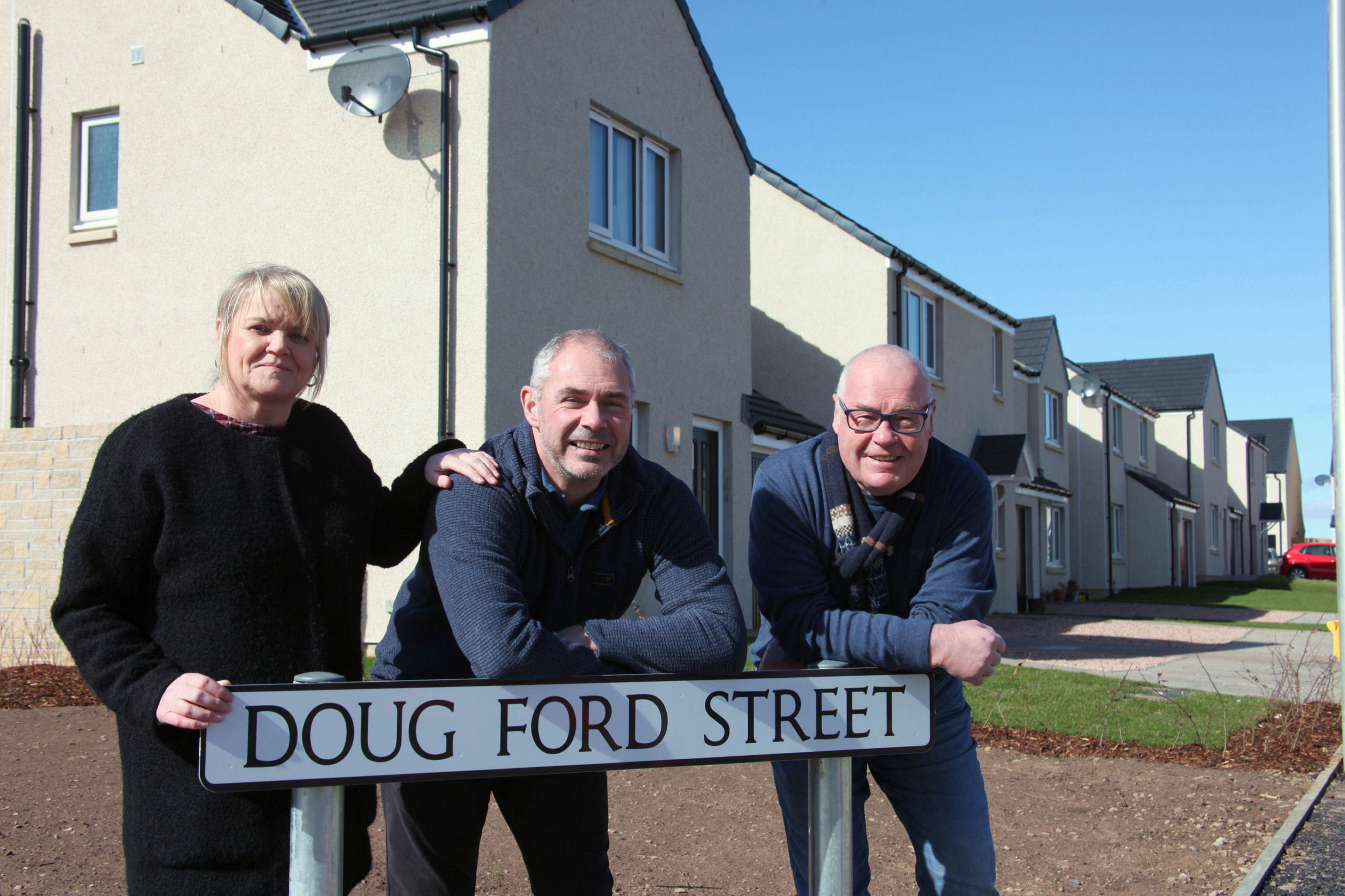 Diane Faulkner, Mark Ford and David Fairweather at the street.