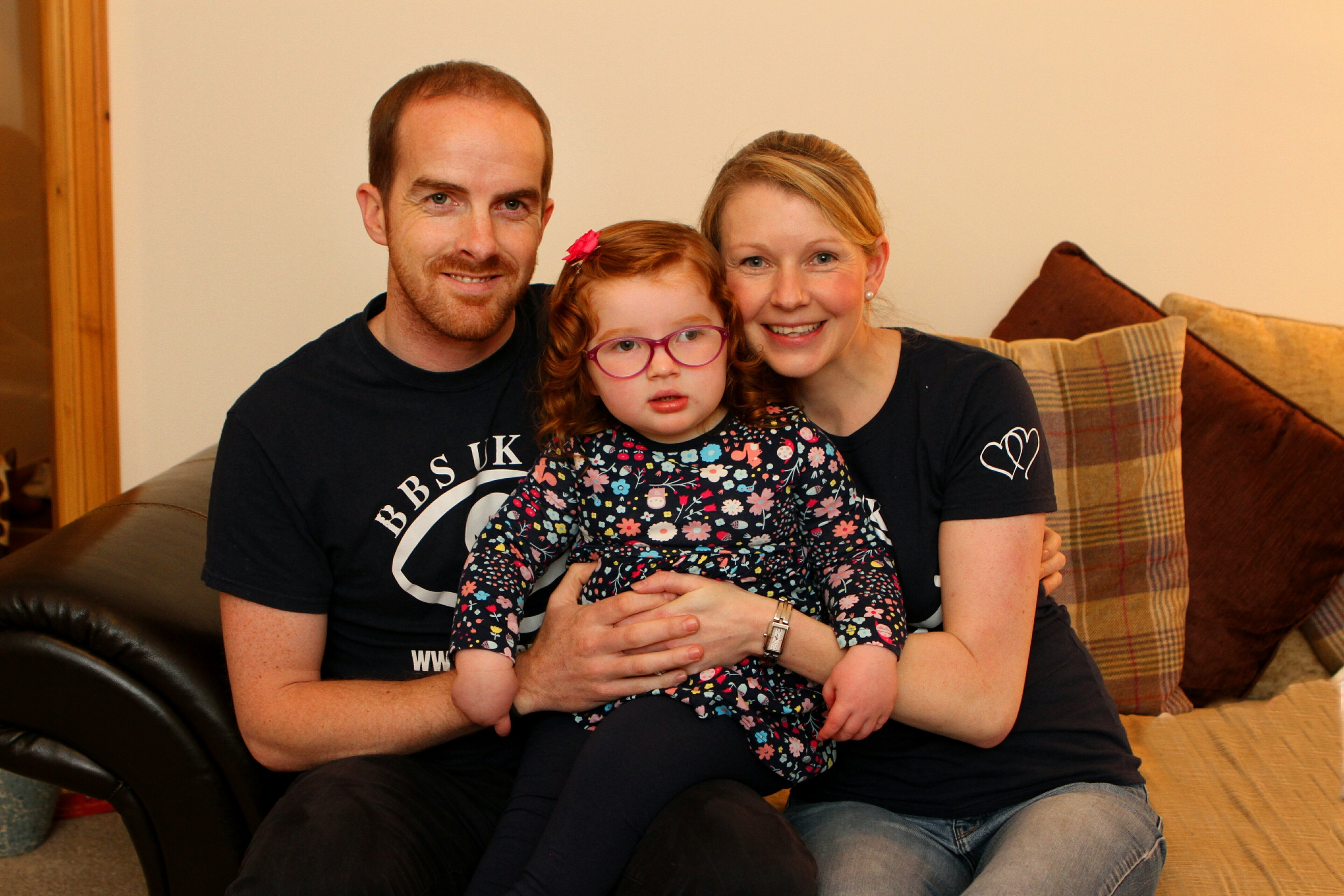 Caitlin Wilkie at home with mum Ashley and  dad Liam.