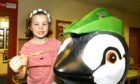 Seven year old Holly Stephen from Glamis helping to paint the penguin.