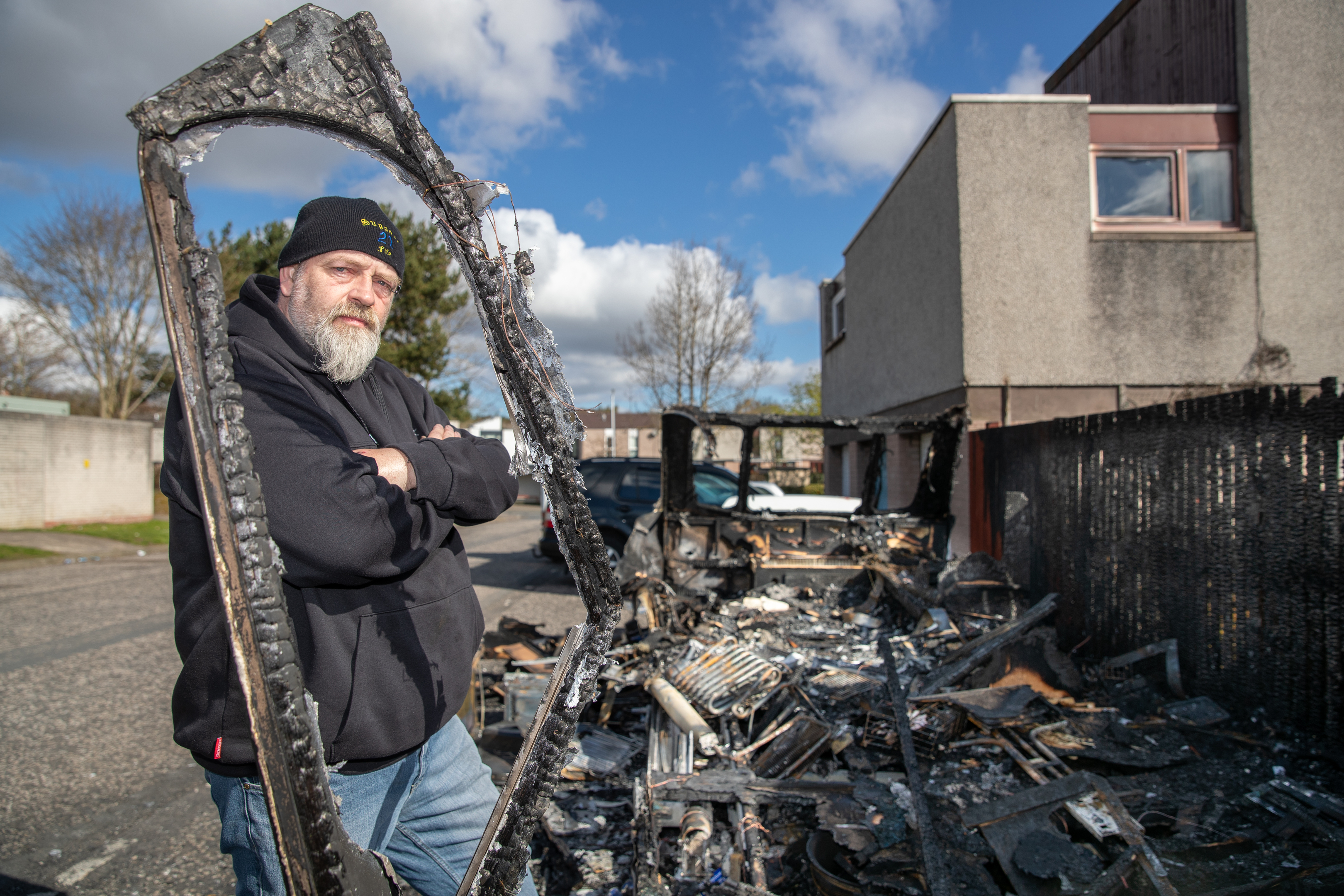 Robert Love by the remains of his burnt-out caravan.