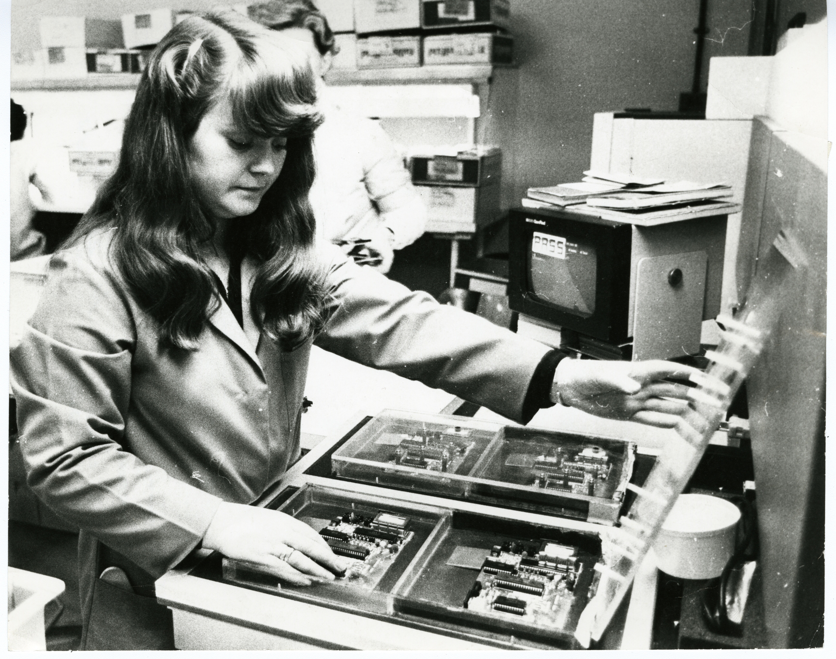 Timex factory worker Margaret Walker on the automatic test equipment machine testing printed circuit boards for a Sinclair computer in 1982.