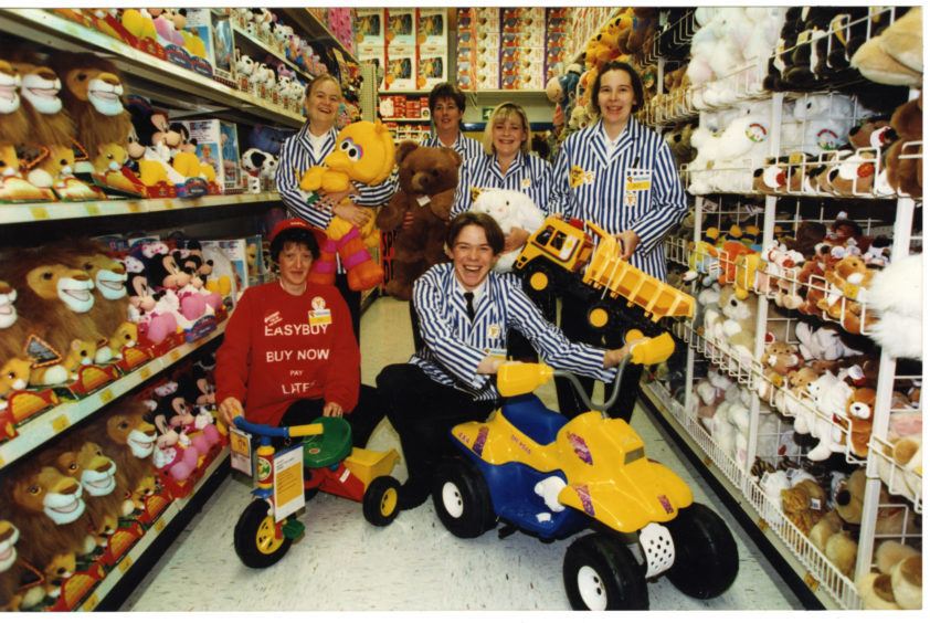 Photograph showing some of the staff members of the then new Toys R Us store located in Kingsway Retail Park, Dundee.