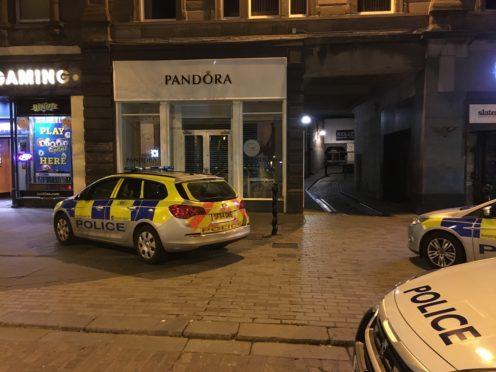 Police on Dundee High Street on Sunday.