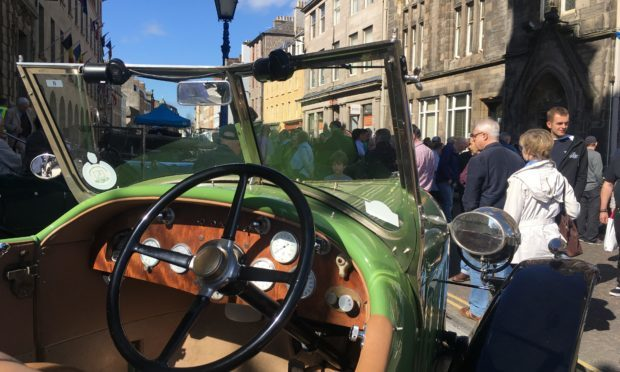 Visitors check out vehicles on Tay Street.