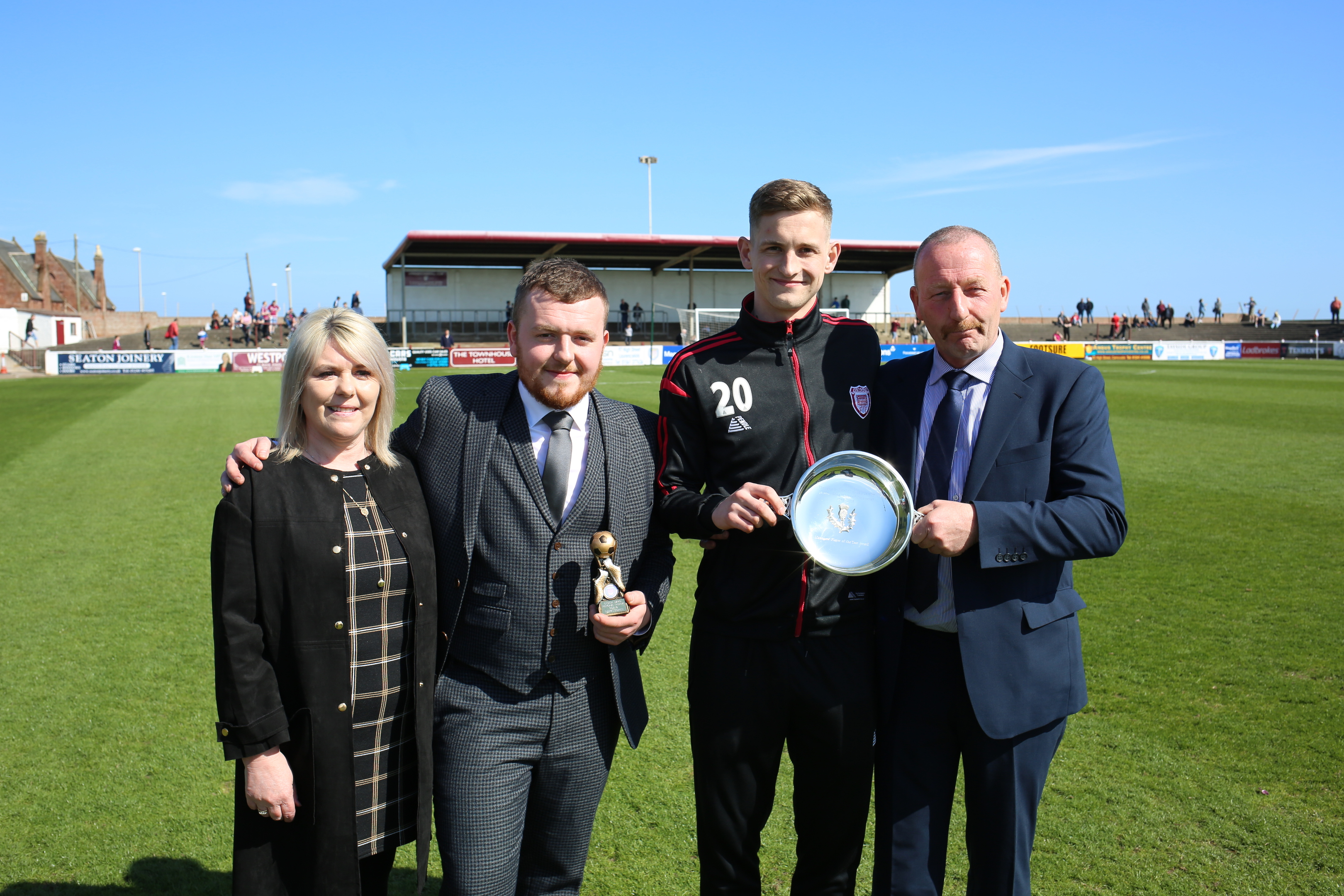 Linda Baird and Reece Baird with Thomas O'Brien being presented with the Geordie Baird Memorial Trophy as the manager's Player of the Year by George Baird.